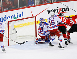 April 9, 2008; Newark, NJ, USA;  New York Rangers goalie Henrik Lundqvist (30) reacts after a goal by New Jersey Devils defenseman Paul Martin (7) during the second period of game 1 of the Eastern Conference Quarterfinal playoffs at the Prudential Center in Newark, NJ.