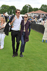 OTIS FERRY and EDIE CAMPBELL at the Cartier Queen's Cup Polo Final, Guards Polo Club, Windsor Great Park, Berkshire, on 17th June 2012.