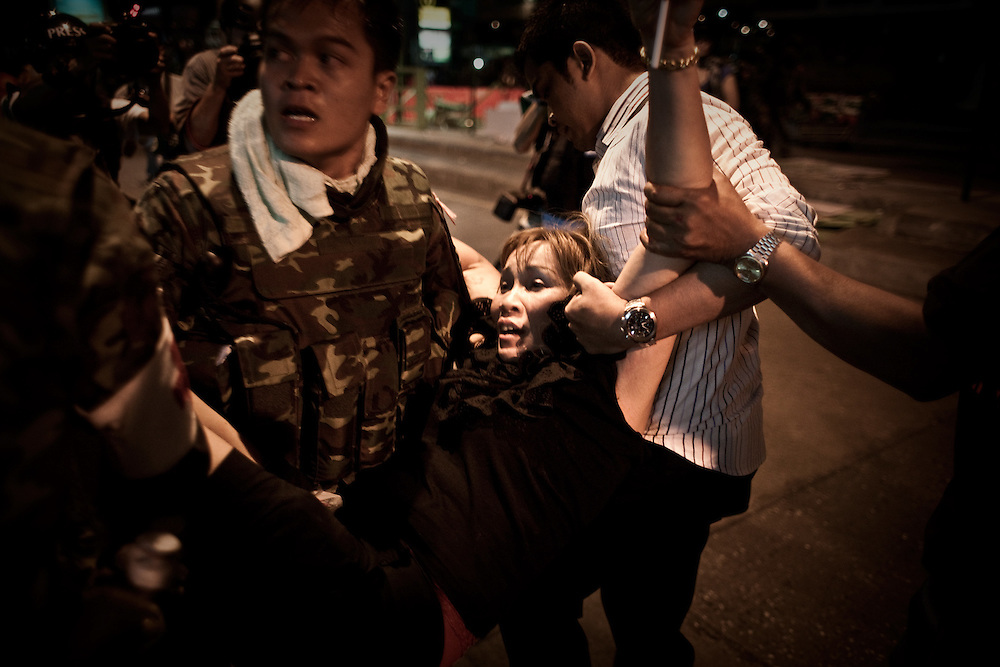 A wounded woman being carried to an ambulance vehicle. For over two months, Thailand's capital was shaken by fierce and deadly cla- shes between protesters and security forces. The standoff has taken the lives of at least 89 people and left way more than 1,800 people injured so far.