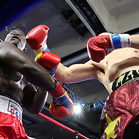 Zhilei Zhang of Zhoukou, China (R) catches Curtis Harper of Jacksonville, Florida with a right hand during a Nelsons Promotions boxing match at the Boca Raton Resort  and Club on Friday, May 26, 2017 in Boca Raton, Florida.  (Alex Menendez via AP)