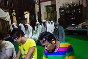 Muslim transgenders and volunteers perform a prayer in a Koran School for transgender in Yogyakarta, Indonesia. The Koran School has to be shut down after a group of Muslim hardliner demand the closure of the activity of the Koran school because according to them in Islam transgender is not exist.