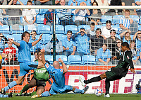 Photo: Ed Godden.<br />Coventry City v Plymouth Argyle. Coca Cola Championship. 30/09/2006. Plymouth's Reuben Reid (far right) misses the ball from close range.