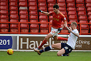 Bolton Wanderers defender David Wheater tackles Nottingham Forest striker Nelson Castro Oliveira during the Sky Bet Championship match between Nottingham Forest and Bolton Wanderers at the City Ground, Nottingham, England on 16 January 2016. Photo by Alan Franklin.