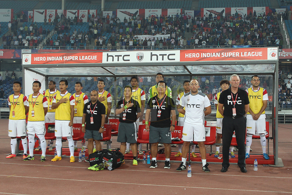 NorthEast United dugout during the national anthem during match 16 of the Hero Indian Super League between The Delhi Dynamos FC and NorthEast United FC held at the Jawaharlal Nehru Stadium, Delhi, India on the 29th October 2014.<br /> <br /> Photo by:  Ron Gaunt/ ISL/ SPORTZPICS