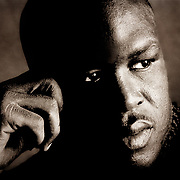 World Heavyweight Boxing Champ Buster Douglas photographed in his hotel room on assignment for The New York Times.