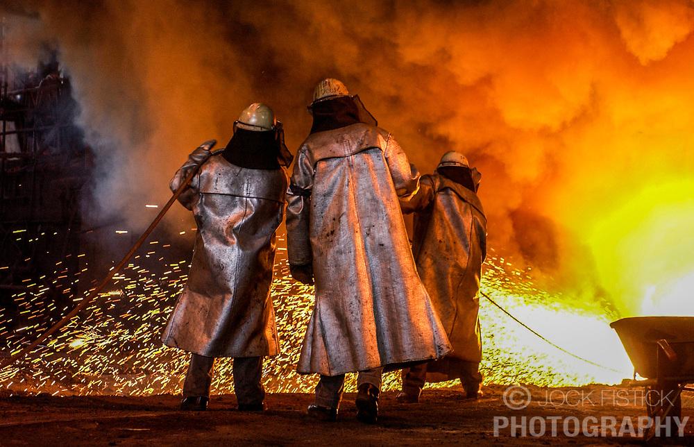 Arcelor employees monitor a blast furnace at the Seraing facility near Liege, Belgium. (Photo © Jock Fistick)