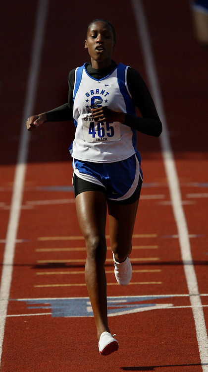 05/14/2009 - Grant's Kayla Greer (465) eases across the finish line to win the women's 400 meter dash. The 6A PIL Varsity District Track Meet takes place at Lewis and Clark College....KEYWORDS:  City, Portland, sports, high school, state, boys, girls
