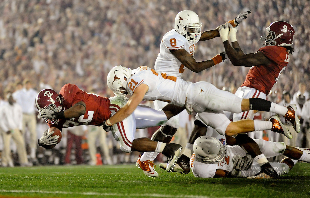 Mark Ingram dives down near the Texas goal line with Blake Gideon making the tackle during the first half in the Rose Bowl.  Photo by Gary Cosby Jr.  01/07/10.