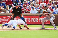 March 29, 2018 - Arlington, TX, U.S. - ARLINGTON, TX - MARCH 29: Texas Rangers second baseman Rougned Odor (12) dives back to first base as Houston Astros left fielder Marwin Gonzalez (9) looks to tag him out during the game between the Texas Rangers and the Houston Astros on March 29, 2018 at Globe Life Park in Arlington, Texas. Houston defeats Texas 4-1. (Photo by Matthew Pearce/Icon Sportswire) (Credit Image: © Matthew Pearce/Icon SMI via ZUMA Press)