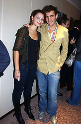 OSCAR HUMPHRIES and SARA PHILIPPIDIS at the UK launch of Tarun Tahiliani Design in association with the British Luxury Council held at The Knightsbridge, London SW7 on 10th March 2005.<br />