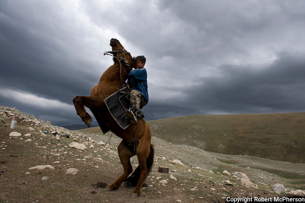 Mongolia.(2008). Kazakh nomad on his horse...Kazakhs are descendants of Turkic and Mongol tribes and are pastoral nomads of the steppes of Kazakhstan and Mongolia. Most of the vast expanses of these countries are steppe; semi-arid land that is desolate and frozen in the winter and turns to lush, green meadow in mid-spring. The steppes are invaluable pastureland for the sheep, horses, cattle, and camels that are essential to the Kazakh people...The ancestors of modern-day Kazakhs were nomadic or semi-nomadic, and many of their customs reflect that lifestyle. Nowadays, people live mostly in cities and villages, although some still lead an agricultural life. The nomadic culture is under threat from these changes in priorities..