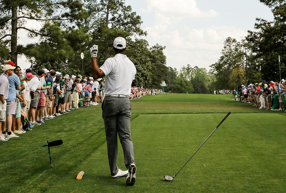 Tiger Woods of the U.S. drops his driver after hitting off the ninth tee and sending the ball onto the first fairway during first round play of the Masters golf tournament at the Augusta National Golf Course in Augusta, Georgia April 9, 2015.   REUTERS/Mark Blinch