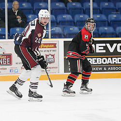 "TRENTON, ON  - MAY 2,  2017: Canadian Junior Hockey League, Central Canadian Jr. ""A"" Championship. The Dudley Hewitt Cup. Game 1 between Dryden GM Ice Dogs and the Georgetown Raiders. Cody Wardner #20 of the Dryden GM Ice Dogs  and Jordan Crocker #9 of the Georgetown Raiders   <br /> (Photo by Amy Deroche / OJHL Images)"