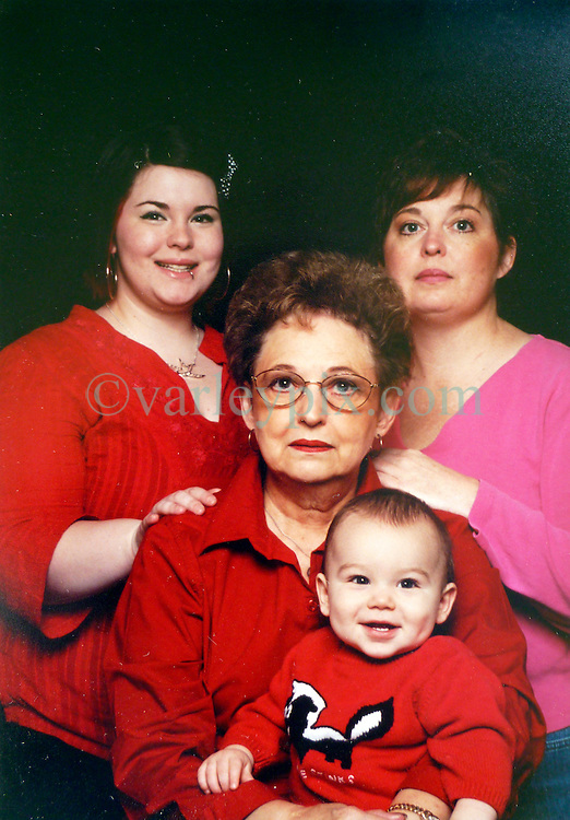 21 May 2015. Laurel, Mississippi.<br /> Collect photos of plus size model Tess Holliday (formerly known as Tess Munster, n&eacute;e Ryann Hoven) in her formative years from a family album. Four generations. Tass and mother Beth (rt), grand mother Carolyn Tadlock with Tess's son Riley.  <br /> Photo credit; Tadlock via Varleypix.com
