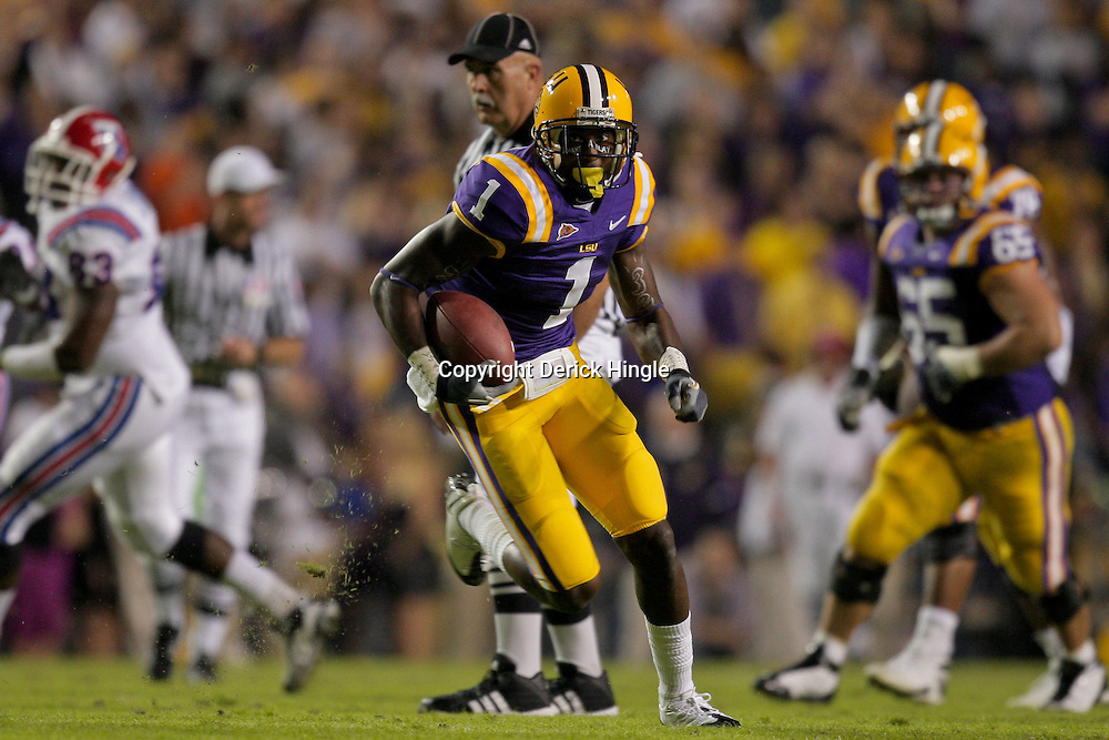 Nov 14, 2009; Baton Rouge, LA, USA; LSU Tigers wide receiver Brandon LaFell (1) runs after a reception for a touchdown against the Louisiana Tech Bulldogs during the first quarter at Tiger Stadium.  Mandatory Credit: Derick E. Hingle-US PRESSWIRE