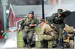 Reenactors portraying panzer grenadiers of the Großdeutschland Division take part in a battle reenactment during the Elsecar 1940's Weekend at Elsecar Heritage Centre 4 September 2010<br />