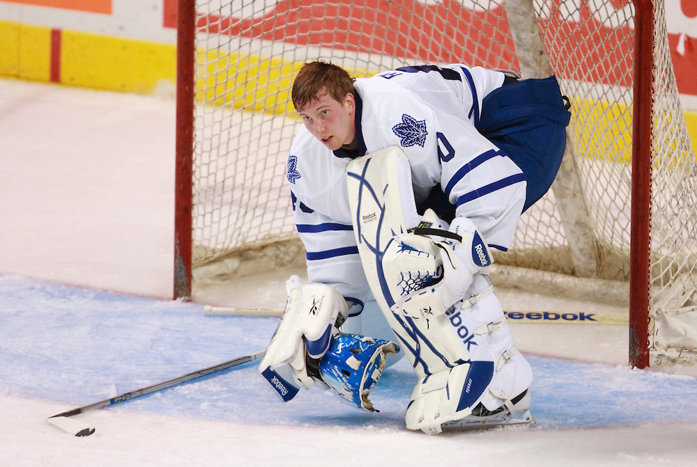 London, Ontario ---10-09-11--- Leaf's rookie goalie Jussi Rynnas picks up his helmet after having it knocked off during the Maple Leafs' first game of the 2010 NHL Rookie Tournament against the Chicago Blackhawks rookies at the John Labatt Centre in London, Ontario, September 11, 2010.<br /> GEOFF ROBINS Toronto Star