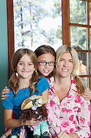 Portrait of mother and daughters smiling