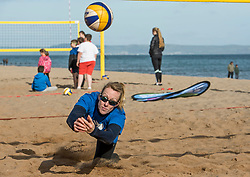 Today marks one year to go before the next Commonwealth Games get underway in Gold Coast, Australia. Athletes from a number of sports joined Scottish Beach Volleyball players, including top duo Lynne Beattie and Mel Coutts, on the new permanent courts on Portobello Beach this morning. The athletes joined with children from Towerbank Primary School to try out the game in the Portobello sunshine.   Pictured: Lynne Beattie<br /> <br /> <br /> © Jon Davey/ EEm