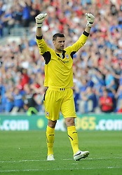 Cardiff City's David Marshall celebrates cardiff third goal of the game.  - Photo mandatory by-line: Alex James/JMP - Tel: Mobile: 07966 386802 25/08/2013 - SPORT - FOOTBALL - Cardiff City Stadium - Cardiff -  Cardiff City V Manchester City - Barclays Premier League