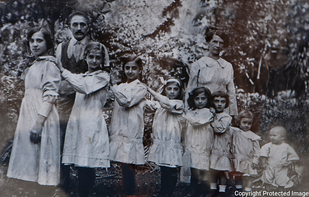 Old ceramic photo of family with seven girls and one boy on a grave in Isola San Michel in Venice, Italy.