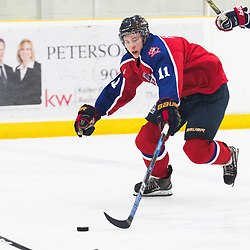 MISSISSAUGA, ON  - JAN 23,  2018: Canadian Junior Hockey League, Prospects Game 2018, Josh Prokop #11 of CJHL Prospect Team West stretches for the puck during the third period.<br /> (Photo by Kevin Raposo / OJHL Images)