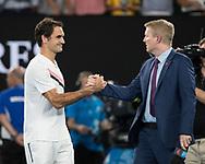 ROGER FEDERER (SUI) begruesst den Channel 7 Moderator Jim Courier fuer ein Post Match Interview auf dem Platz<br /> Tennis - Australian Open 2018 - Grand Slam / ATP / WTA -  Melbourne  Park - Melbourne - Victoria - Australia  - 26 January 2018.