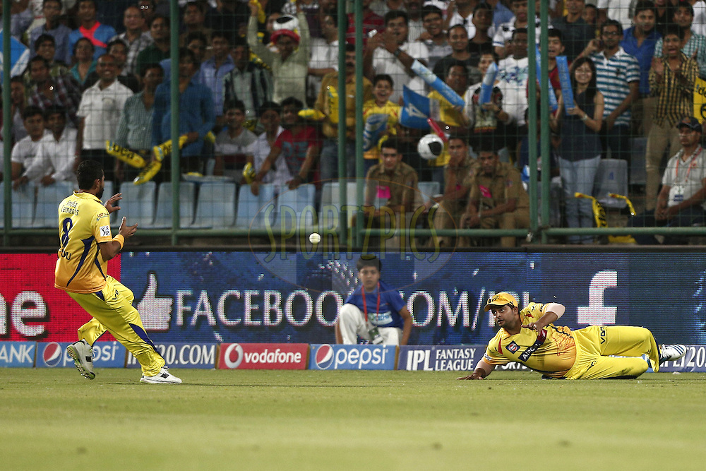 Suresh Raina/Jadeja/Sharma of The Chennai Superkings take the wicket of Quinton de Kock of the Delhi Daredevils  during match 26 of the Pepsi Indian Premier League Season 2014 between the Delhi Daredevils and the Chennai Superkings held at the Ferozeshah Kotla cricket stadium, Delhi, India on the 5th May  2014<br /> <br /> Photo by Deepak Malik / IPL / SPORTZPICS<br /> <br /> <br /> <br /> Image use subject to terms and conditions which can be found here:  http://sportzpics.photoshelter.com/gallery/Pepsi-IPL-Image-terms-and-conditions/G00004VW1IVJ.gB0/C0000TScjhBM6ikg