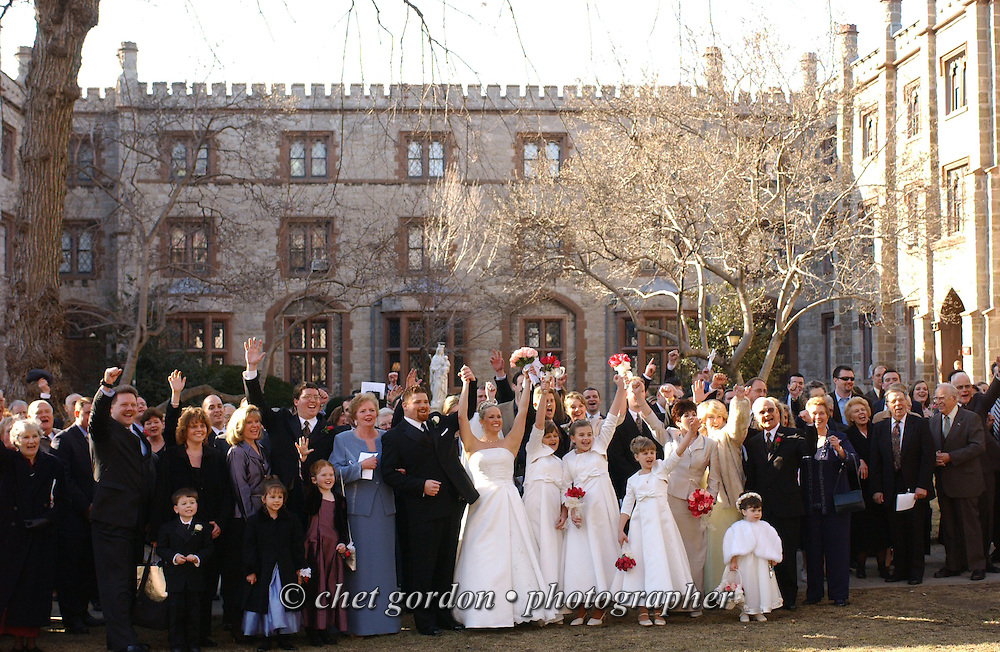 """The wedding party along with newlyweds Michael Orlando and Alison Anne Reitter (center) pose for a group photograph outside The University Church on the campus of Fordham University in the Bronx, NY after their wedding ceremony on Saturday, March 15, 2003.  Quote from the Best Man, Christopher Orlando: """" Michael and Alison are soulmates, not one created on TV or made over a couple of weeks. Their relationship is built to last."""" (Photograph by Chet Gordon for The New York Daily News)"""
