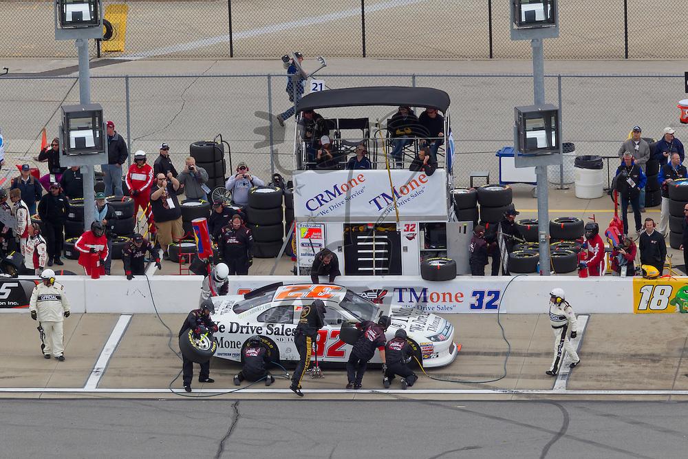 KANSAS CITY, KS - APR 22, 2012:  Reed Sorenson (32) races during the STP 400 at the Kansas Speedway in Kansas City, KS.