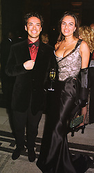 MR & MRS HENRY DENT-BROCKLEHURST at a fashion show in London on 17th November 1998.MMC 6