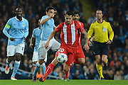 Sevilla  midfielder Vitolo skips away from Manchester City midfielder Jesus Navas during the Champions League Group D match between Manchester City and Sevilla at the Etihad Stadium, Manchester, England on 21 October 2015. Photo by Alan Franklin.