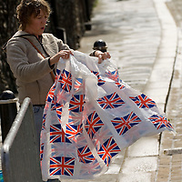 Woman folding a plastic sheet with union jack motive