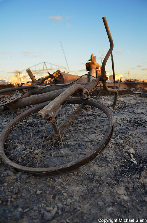 Bicycle burned and charred lays in the aftermath