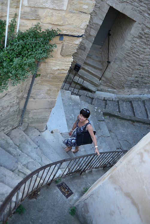 Woman walking up stairs,Gordes,Vaucluse,Provence,France,Europe<br /> Model release 0351