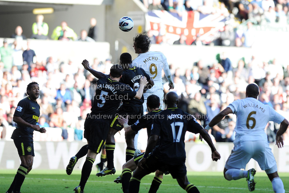 Swansea city's Michu (9) rises to head from a corner. Barclays Premier league, Swansea city v Wigan Athletic at the Liberty Stadium in Swansea, South Wales on Saturday 20th October 2012. pic by Andrew Orchard, Andrew Orchard sports photography,