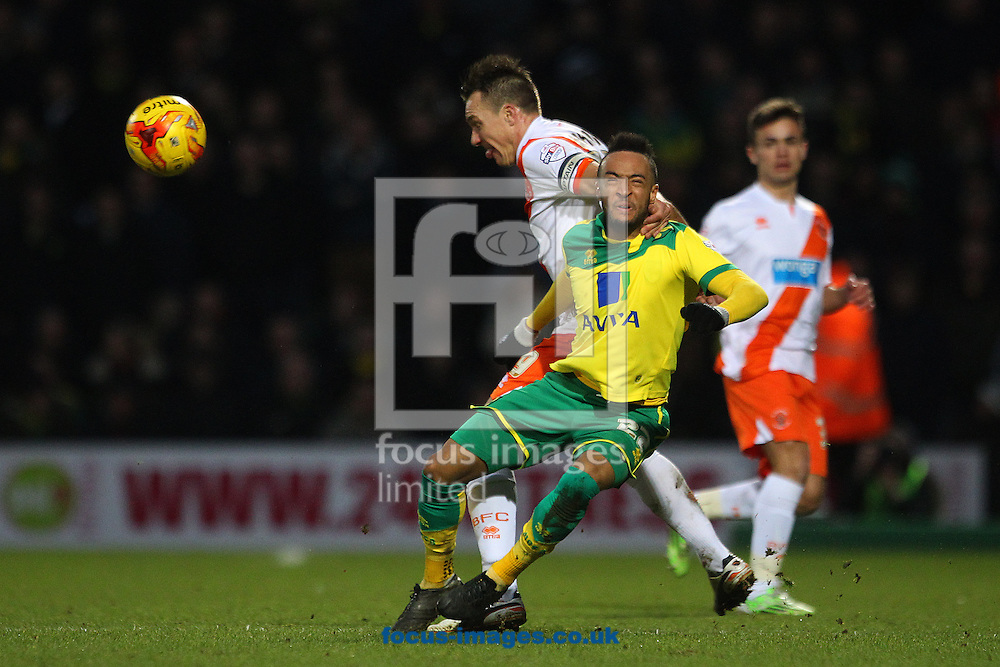 Nathan Redmond of Norwich is fouled by Anthony McMahon of Blackpool during the Sky Bet Championship match at Carrow Road, Norwich<br /> Picture by Paul Chesterton/Focus Images Ltd +44 7904 640267<br /> 07/02/2015