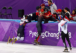 February 17, 2018 - Gangneung, South Korea - Short track skater John-Henry Krueger of the United States and  Samuel Girard of Canada celebrates with their coaches after Kreuger won a silver medal and Girad won gold medal in the Men's Short Track Speed Skating 1000M finals at the PyeongChang 2018 Winter Olympic Games at Gangneung Ice Arena on Saturday February 17, 2018. (Credit Image: © Paul Kitagaki Jr. via ZUMA Wire)