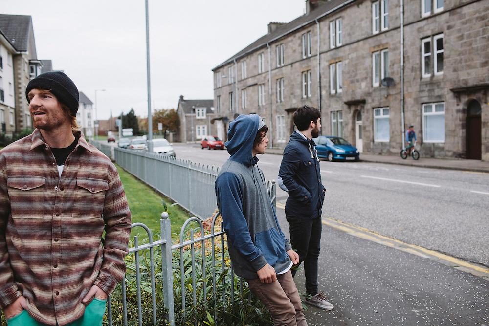 Jason Phelan, Kriss Kyle and Scott Quinn wait on a street corner in the town of Dumbarton, Scotland.