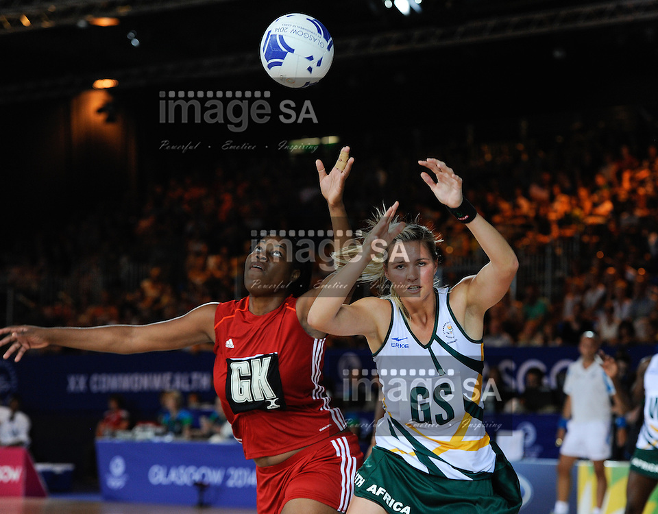 GLASGOW, SCOTLAND - JULY 25: Daystar Swift of Trinidad and Tobago and Lenise Potgieter of South Africa tussle for the ball during the netball match between South Africa and Trinidad and Tobago on day 2 of the 20th Commonwealth Games at Scottish Exhibition Centre on July 25, 2014 in Glasgow, Scotland. (Photo by Roger Sedres/ImageSA)