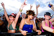 Three girls dancing, Global Gathering festival, Long Marston Airfield, Stoke on Trent, UK. 28/29 July 2006