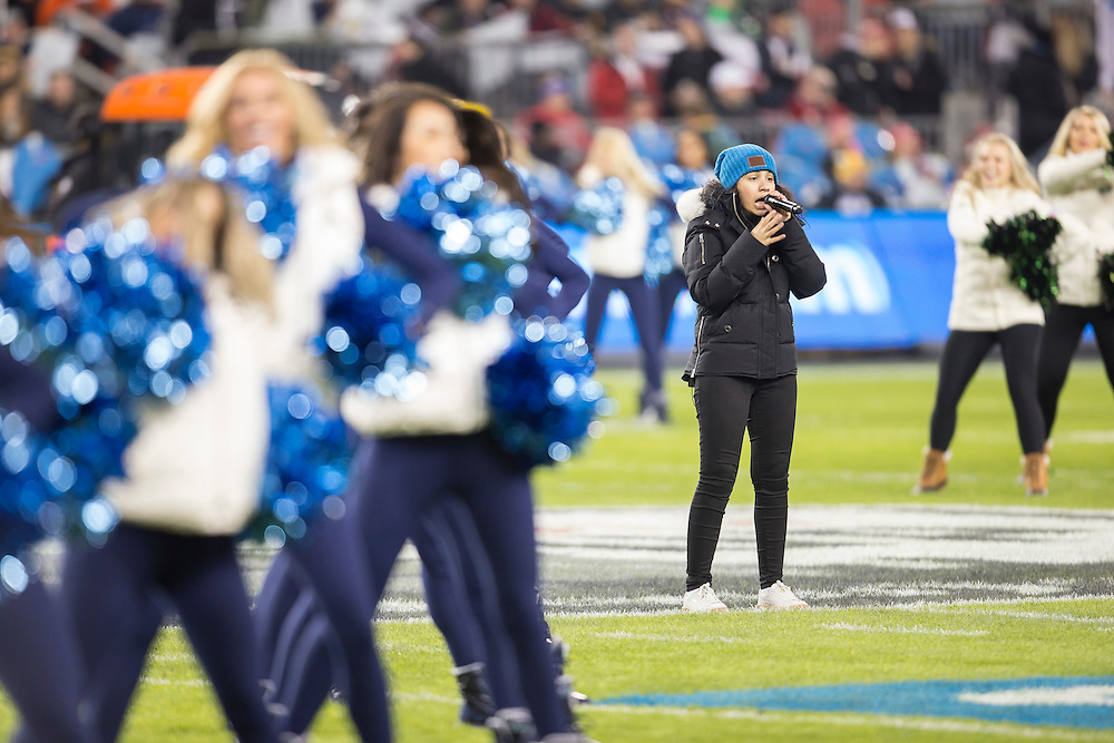 Alessia Cara sings during the kickoff show for the before the 104th Grey Cup Final game between the Calgary Stampeders and Ottawa Redblacks in Toronto Ontario, Sunday,  November 27, 2016.  (CFL PHOTO - Geoff Robins)