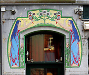 Detail from an art Nouveau decorative frieze surrounding a door to a shop in Amsterdam. Dutch style circa 1905
