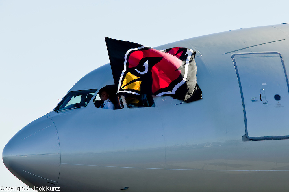 Feb 2, 2009 -- PHOENIX, AZ: The Arizona Cardinals flag flies from the window of the plane bringing the team back to Phoenix Monday. More than 4,000 people came to Sky Harbor Airport in Phoenix to welcome home the Arizona Cardinals, the city's NFL team. The Cardinals lost the Superbowl to the Pittsburgh Steelers 27 - 23.   Photo By Jack Kurtz / ZUMA Press