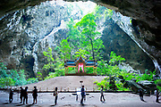 13 May 2017. Phraya Nakhon Cave, Thailand.<br /> Visitors take a look at The Tetrahedron Pavilion deep inside Phraya Nakhon Cave, Thailand. The natural cave is an historic place in Thailand due to three great Thai King's visiting it in the past. <br /> Photographer: Rick Findler