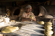 Akbar Zareh, a baker who has worked seven days a week at the job since he was a young boy, in Yazd, Iran. MODEL RELEASED.