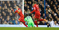 LONDON, ENGLAND - Sunday, December 15, 2013: Liverpool's captain Luis Suarez celebrates scoring the first goal against Tottenham Hotspur during the Premiership match at White Hart Lane. (Pic by David Rawcliffe/Propaganda)