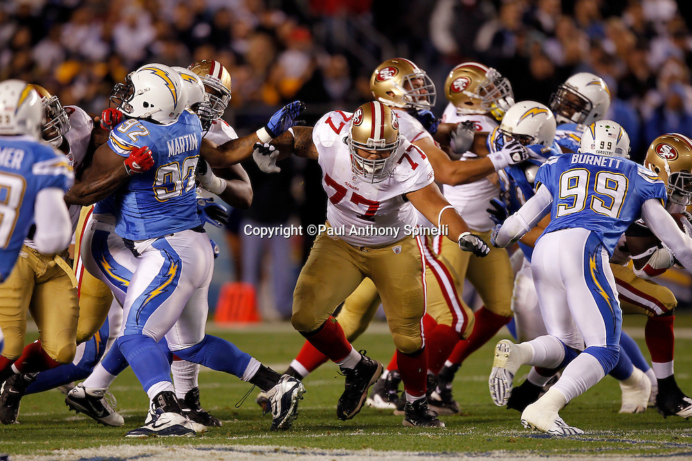 San Francisco 49ers guard Mike Iupati (77) blocks during the NFL week 15 football game against the San Diego Chargers on Thursday, December 16, 2010 in San Diego, California. The Chargers won the game 34-7. (©Paul Anthony Spinelli)