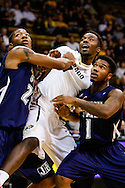 November 16th, 2013:  Colorado Buffaloes redshirt freshman forward Wesley Gordon (1) is held back by a pair Jackson State Tigers players during the second half of the NCAA Basketball game between the Jackson State Tigers and the University of Colorado Buffaloes at the Coors Events Center in Boulder, Colorado