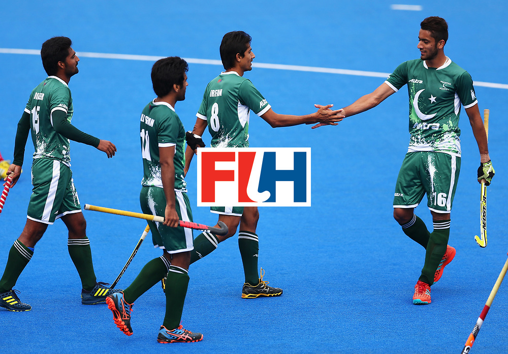LONDON, ENGLAND - JUNE 25: Muhammad Irfan Jr. of Pakistan celebrates scoring his sides third goal with his Pakistan team mates during the 7th/8th place match between Pakistan and China on day nine of the Hero Hockey World League Semi-Final at Lee Valley Hockey and Tennis Centre on June 25, 2017 in London, England.  (Photo by Steve Bardens/Getty Images)